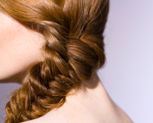 Close-up of woman with braid in hair